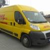 Stylizacja koloru karoserii auta z białego na żółty dla firmy kurierskiej DHL- Advert Studio