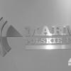 Logowanie recepcji fabryki MARMA Polskie folie. Litery przestrzenne styrodurowe z czołem z  dibondu o efekcie szczotkowanego aluminium. Advert Studio.