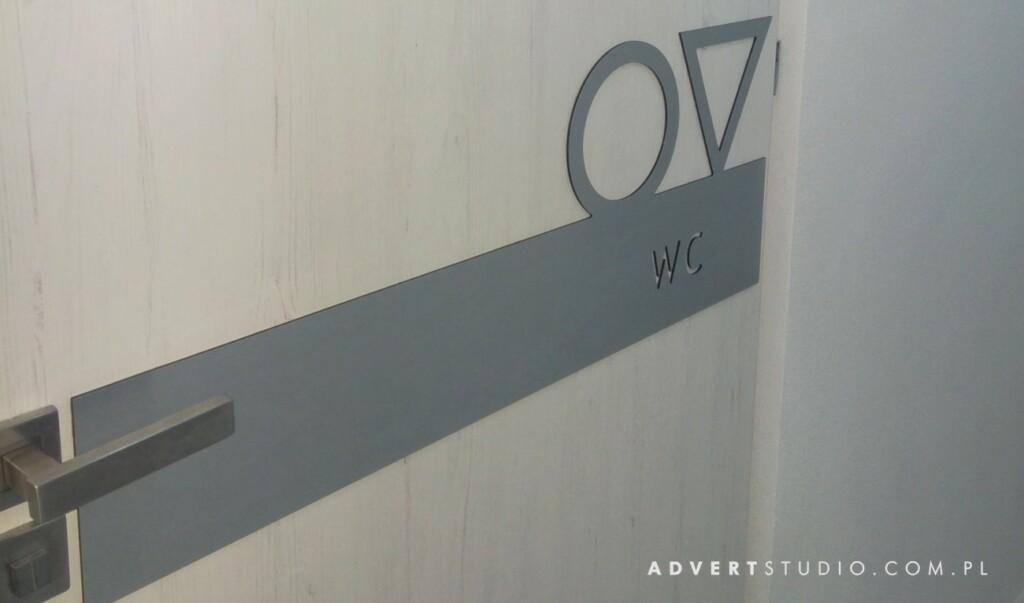 OZNAKOWANIE drzwi w klinice stomatologii - producent reklam advert