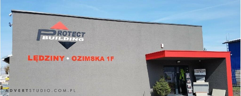 OZNAKOWANIE BUDYNKU - PROTECT BUILDING ADVERT